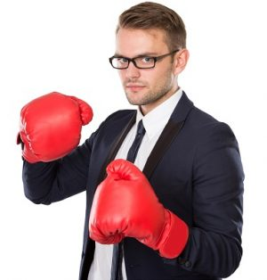 portrait of Businessman wearing boxing gloves, conceptual. ready for your design